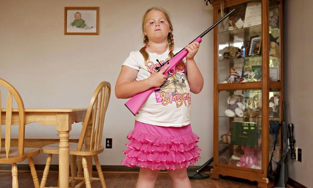 Abby, aged 8, from Louisiana, photographed by   An-Sofie Kesteleyn for her series My Little Rifle