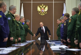Russian President Vladimir Putin shakes hands with Defence Minister Sergei Shoigu during a meeting at the Bocharov Ruchei state residence in Sochi