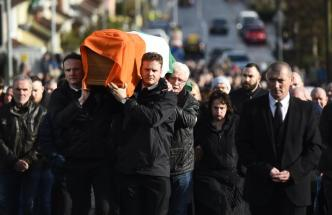 Fiachra and Emmet McGuinness carry their father Martin McGuinness' coffin through the streets of Londonderry, Northern Ireland
