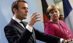Emmanuel-Macron-with-Angela-Merkel-935574